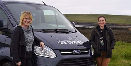 Lorna and Carrie in front of the See Orkney van with the Brough of Birsay in the background